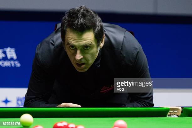 Ronnie O'Sullivan of England reacts during the semifinal match against John Higgins of Scotland on day five of 2017 Shanghai Masters at Shanghai...