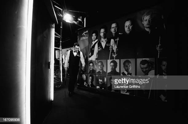 Ronnie O'Sullivan of England walks backstage at the end of his morning session during the Betfair World Snooker Championship at the Crucible Theatre...