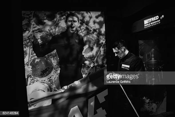 Ronnie O'Sullivan of England walks out for his second round match against Barry Hawkins of England on day ten of the World Snooker Championship at...