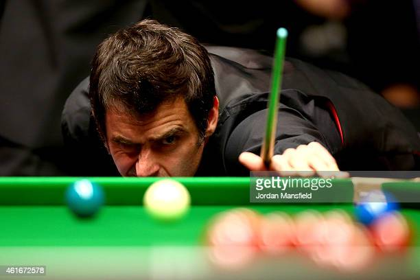Ronnie O'Sullivan of Great Britain lines up a shot during his semifinal match against Neil Robertson of Australia on day seven of the 2015 Dafabet...
