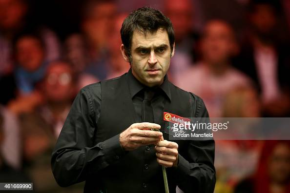 Ronnie O'Sullivan of Great Britain looks on during his semifinal match against Neil Robertson of Australia on day seven of the 2015 Dafabet Masters...
