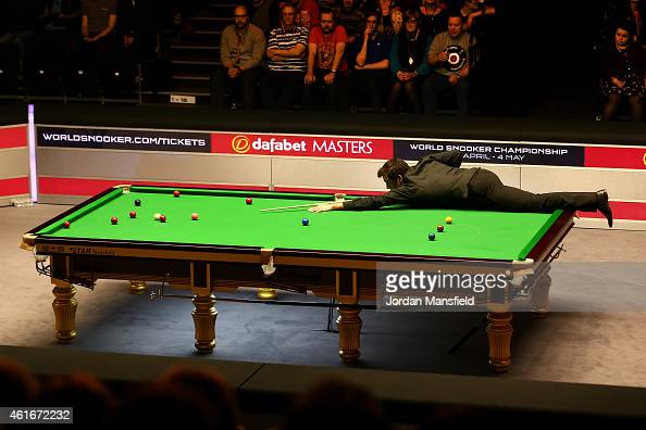 Ronnie O'Sullivan of Great Britain plays a shot during his semifinal match against Neil Robertson of Australia on day seven of the 2015 Dafabet...