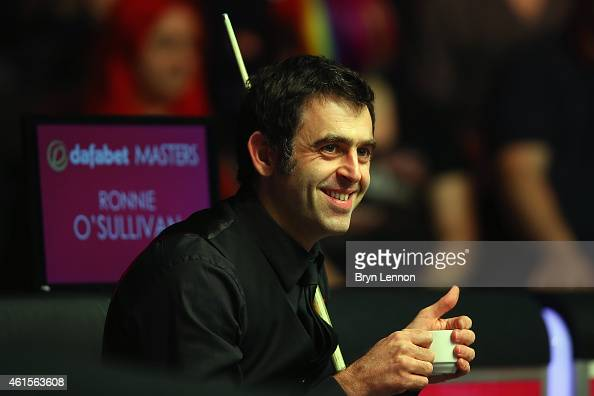Ronnie O'Sullivan of Great Britain reacts to the crowd after breaking Stephen Hendry's alltime centuries record of 775 in his game against Marco Fu...