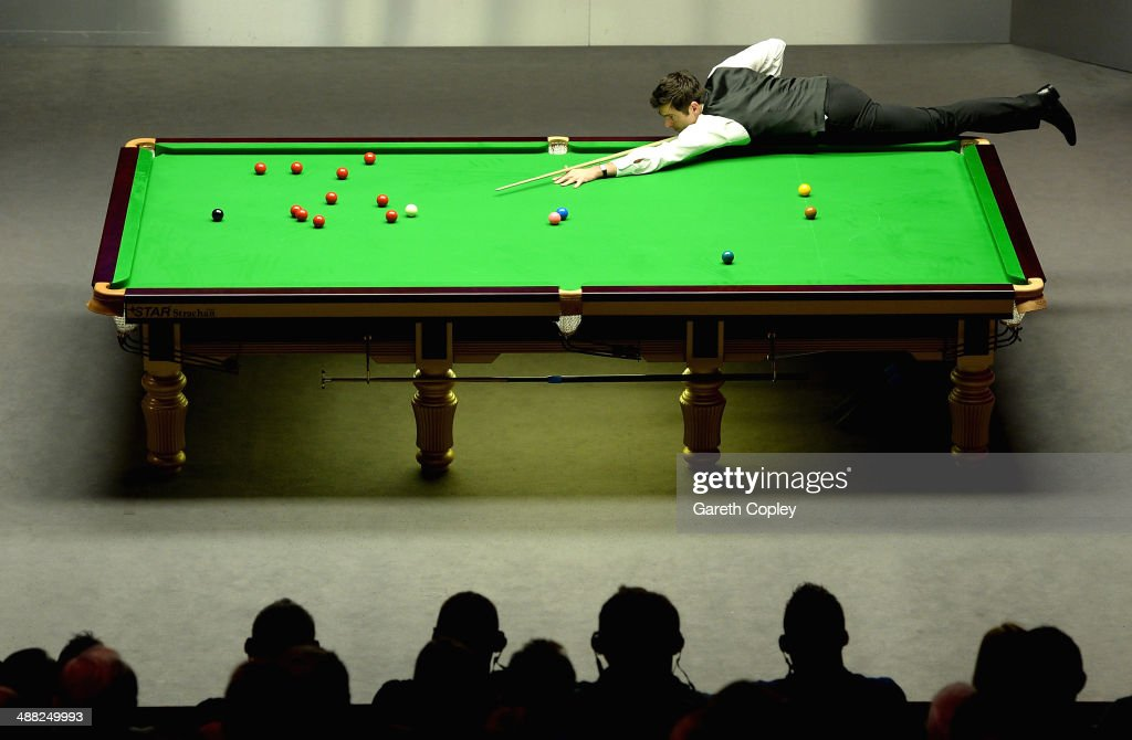 <a gi-track='captionPersonalityLinkClicked' href=/galleries/search?phrase=Ronnie+O%27Sullivan&family=editorial&specificpeople=208991 ng-click='$event.stopPropagation()'>Ronnie O'Sullivan</a> plays a shot against Mark Selby during The Dafabet World Snooker Championship final at Crucible Theatre on May 4, 2014 in Sheffield, England.