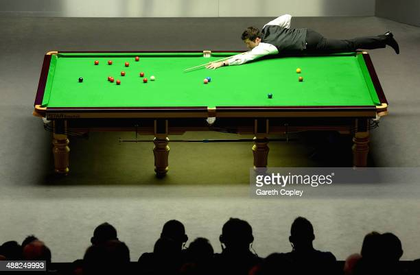 Ronnie O'Sullivan plays a shot against Mark Selby during The Dafabet World Snooker Championship final at Crucible Theatre on May 4 2014 in Sheffield...