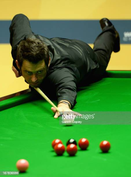 Ronnie O'Sullivan plays a shot against Stuart Bingham during their Quarter Final match in the Betfair World Snooker Championship at the Crucible...