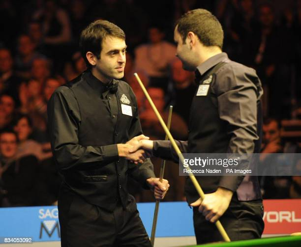 Ronnie O'Sullivan shakes hands with Stephen Maguire after being knocked out of the Saga Insurance Masters during the SAGA Insurance Masters at...
