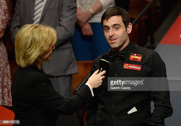 Ronnie O'Sullivan speaks BBC presenter Hazel Irvine after losing The Dafabet World Snooker Championship final at Crucible Theatre on May 5 2014 in...