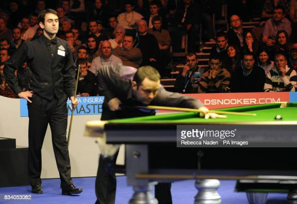 Ronnie O'Sullivan watches the final shot of his match by Stephen Maguire who knocked him out during the SAGA Insurance Masters at Wembley Arena London