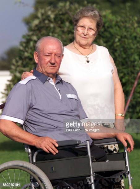 Ronnie Pollock with his wfe Georgie outside their County Down home Mr Pollock a former policeman lost his legs when a booby trap bomb exploded under...