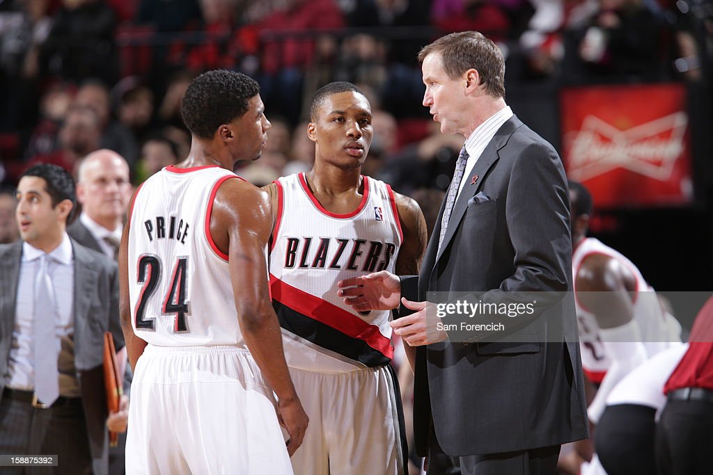 Ronnie Price #24 and Damian Lillard #0 talk with Terry Stotts of the Portland Trail Blazers against the Philadelphia 76ers on December 29, 2012 at the Rose Garden Arena in Portland, Oregon.