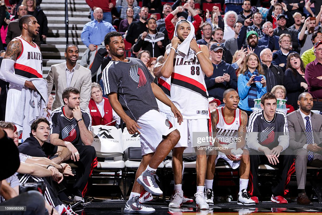 Ronnie Price #24 and Nicolas Batum #88 of the Portland Trail Blazers celebrate from the sideline during a game against the Indiana Pacers on January 23, 2013 at the Rose Garden Arena in Portland, Oregon.
