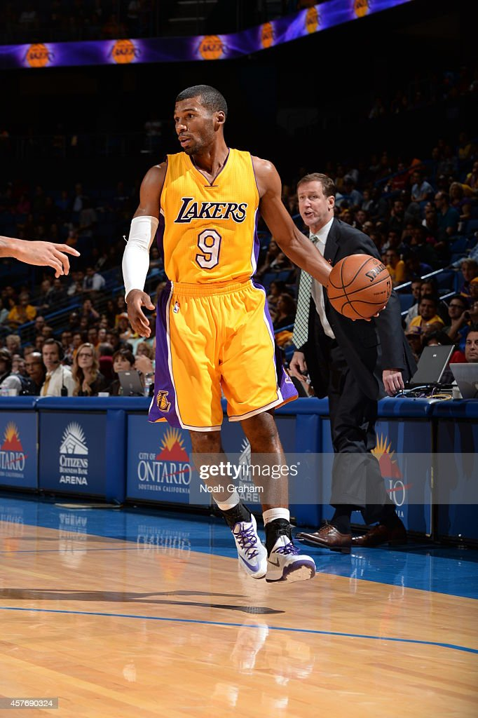 Ronnie Price of the Los Angeles Lakers dribbles down court against the Portland Trail Blazers at the Citizens Business Bank Arena in Ontario...