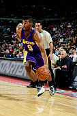 Ronnie Price of the Los Angeles Lakers drives against the Detroit Pistons on December 2 2014 at The Palace of Auburn Hills in Auburn Hills Michigan...