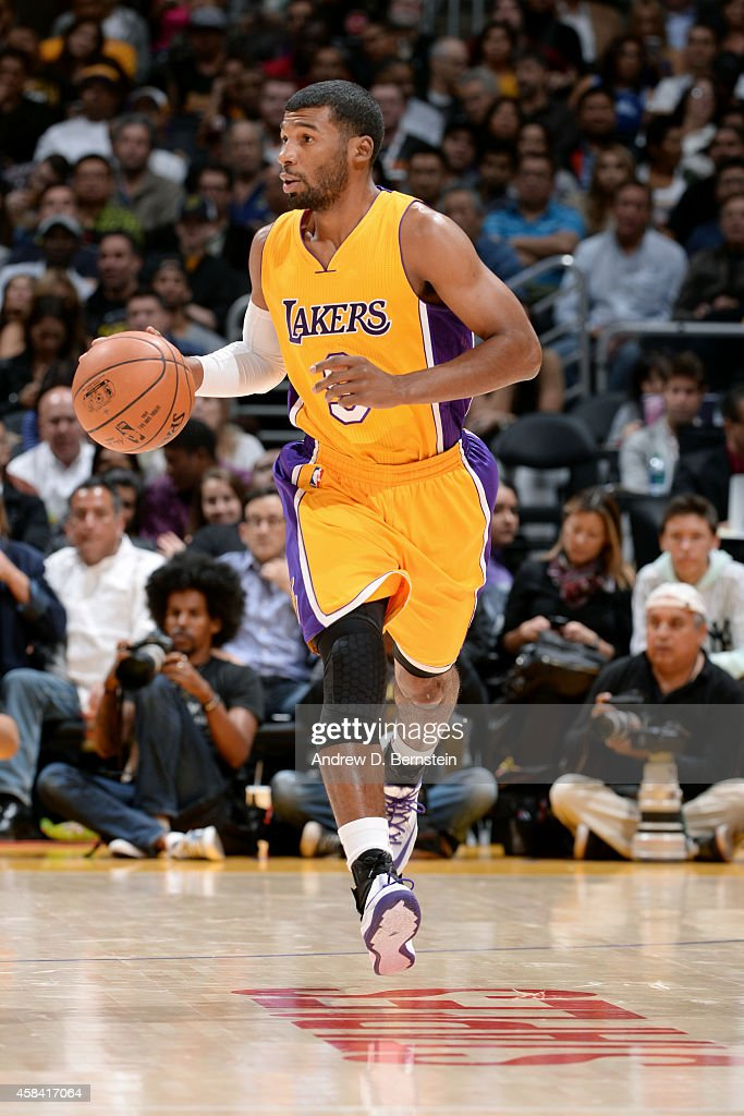 Ronnie Price of the Los Angeles Lakers drives against the Phoenix Suns at STAPLES Center on November 04 2014 in Los Angeles California NOTE TO USER...