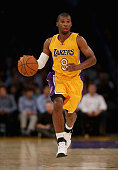 Ronnie Price of the Los Angeles Lakers drives down the court against the Golden State Warriors at Staples Center on October 9 2014 in Los Angeles...