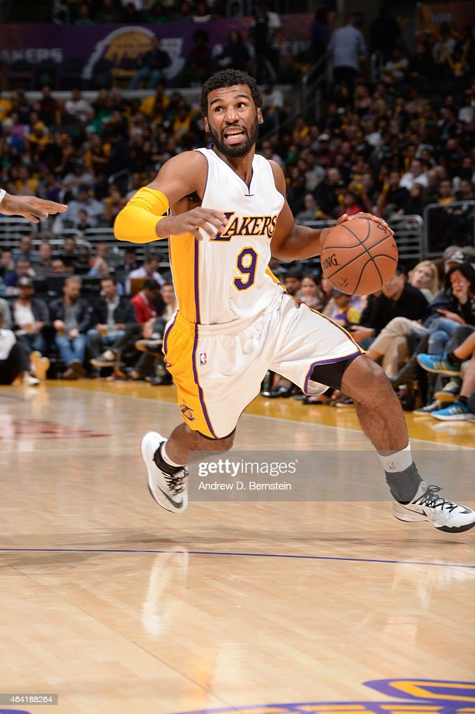 Ronnie Price of the Los Angeles Lakers drives to the basket against the Boston Celtics on February 22 2015 at Staples Center in Los Angeles...