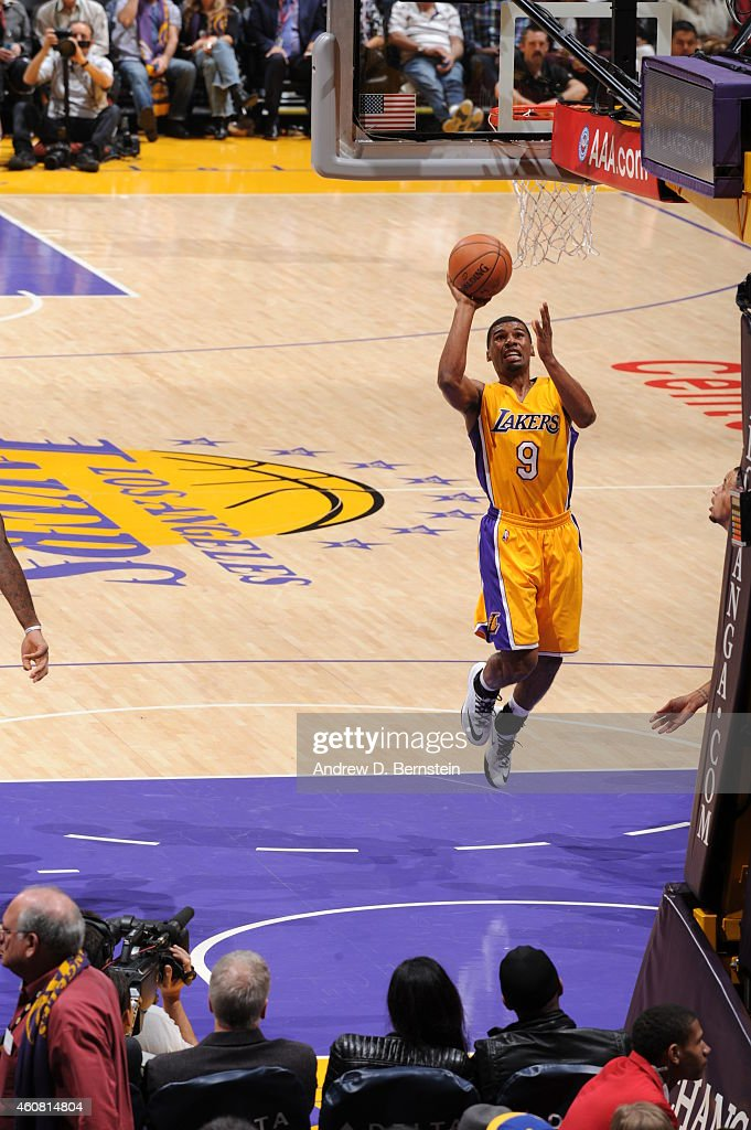 Ronnie Price of the Los Angeles Lakers goes to the basket against the Golden State Warriors on December 23 2014 at Staples Center in Los Angeles...
