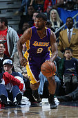 Ronnie Price of the Los Angeles Lakers handles the ball against the New Orleans Pelicans on November 12 2014 at the Smoothie King Center in New...