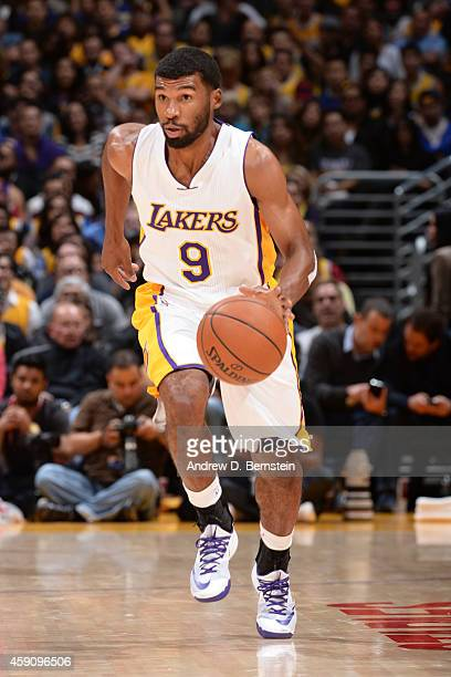 Ronnie Price of the Los Angeles Lakers handles the ball against the Golden State Warriors on November 16 2014 at Staples Center in Los Angeles...