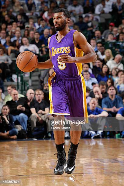 Ronnie Price of the Los Angeles Lakers handles the ball against the Dallas Mavericks during the game on November 21 2014 at the American Airlines...