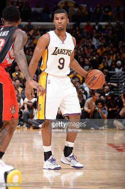 Ronnie Price of the Los Angeles Lakers handles the ball against the Toronto Raptors at STAPLES Center on November 30 2014 in Los Angeles California...