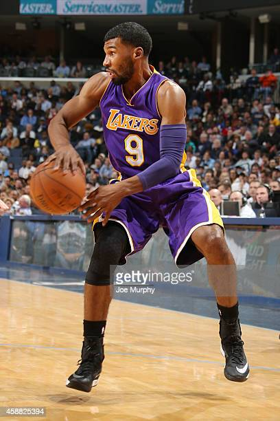 Ronnie Price of the Los Angeles Lakers passes the ball during the game on November 11 2014 at FedEx Forum in Memphis Tennessee NOTE TO USER User...