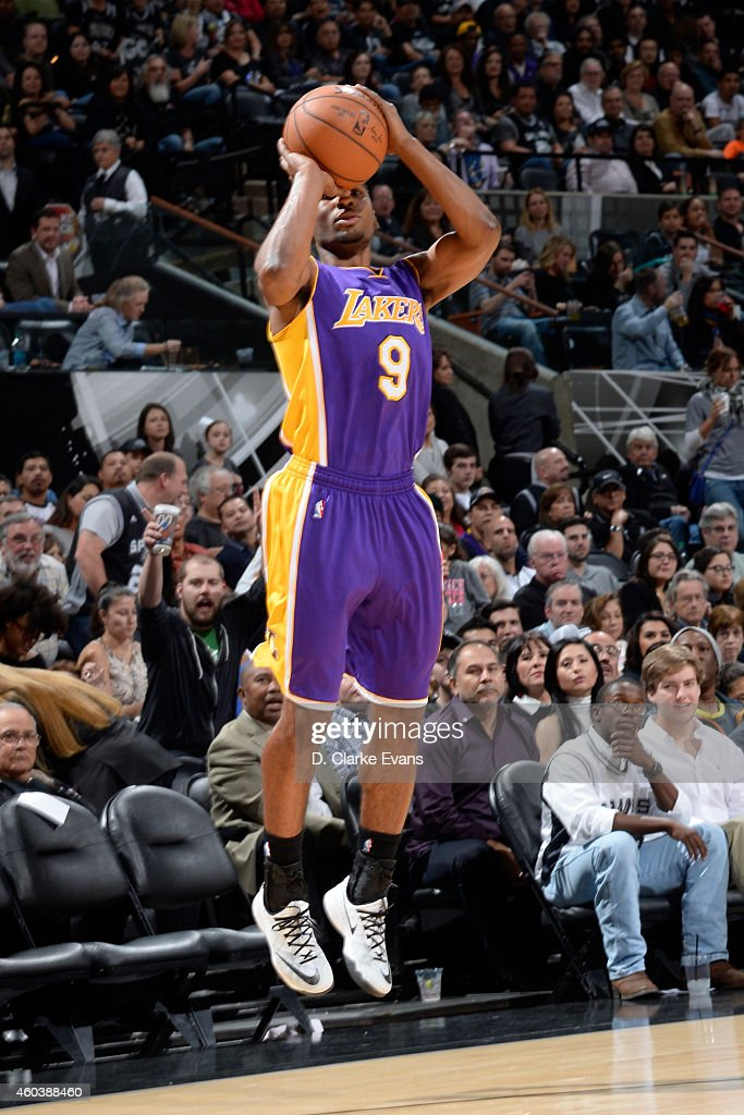 Ronnie Price of the Los Angeles Lakers takes a shot against the San Antonio Spurs at the ATT Center on December 12 2014 in San Antonio Texas NOTE TO...