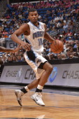 Ronnie Price of the Orlando Magic dribbles the ball against the Portland Trail Blazers during the game on March 25 2014 at Amway Center in Orlando...