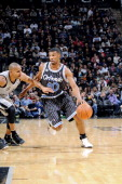 Ronnie Price of the Orlando Magic drives against the San Antonio Spurs at the ATT Center on March 8 2014 in San Antonio Texas NOTE TO USER User...