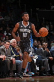 Ronnie Price of the Orlando Magic handles the ball against the Washington Wizards on December 2 2013 in Washington DC at the Verizon Center NOTE TO...