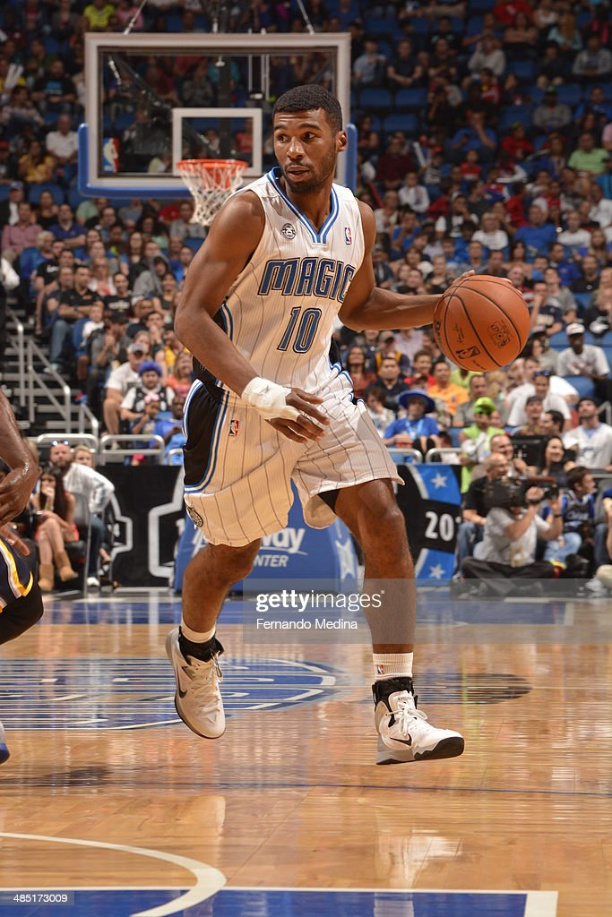 Ronnie Price of the Orlando Magic handles the ball against the Indiana Pacers on April 16 2014 at Amway Center in Orlando Florida NOTE TO USER User...