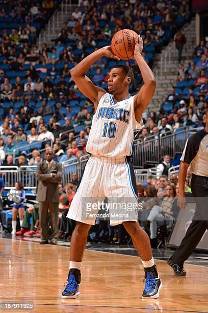 Ronnie Price of the Orlando Magic looks to pass the ball against the Milwaukee Bucks during the game on November 13 2013 at Amway Center in Orlando...