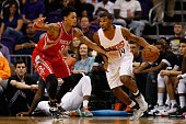 Ronnie Price of the Phoenix Suns handles the ball under pressure from KJ McDaniels of the Houston Rockets during the first half of the preseason NBA...