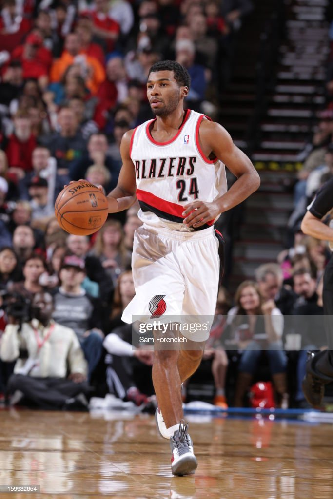 <a gi-track='captionPersonalityLinkClicked' href=/galleries/search?phrase=Ronnie+Price&family=editorial&specificpeople=654750 ng-click='$event.stopPropagation()'>Ronnie Price</a> #24 of the Portland Trail Blazers brings the ball up court against the Washington Wizards on January 21, 2013 at the Rose Garden Arena in Portland, Oregon.