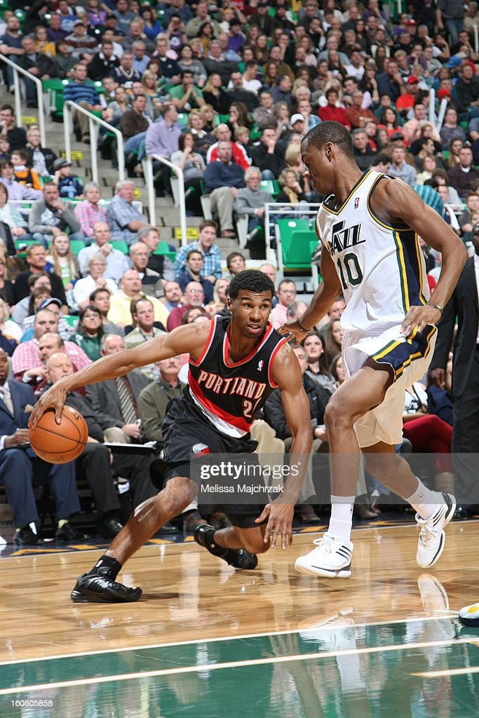 <a gi-track='captionPersonalityLinkClicked' href=/galleries/search?phrase=Ronnie+Price&family=editorial&specificpeople=654750 ng-click='$event.stopPropagation()'>Ronnie Price</a> #24 of the Portland Trail Blazers drives against <a gi-track='captionPersonalityLinkClicked' href=/galleries/search?phrase=Alec+Burks&family=editorial&specificpeople=6834208 ng-click='$event.stopPropagation()'>Alec Burks</a> #10 of the Utah Jazz at Energy Solutions Arena on February 01, 2013 in Salt Lake City, Utah.