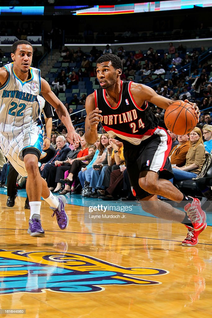 <a gi-track='captionPersonalityLinkClicked' href=/galleries/search?phrase=Ronnie+Price&family=editorial&specificpeople=654750 ng-click='$event.stopPropagation()'>Ronnie Price</a> #24 of the Portland Trail Blazers drives against Brian Roberts #22 of the New Orleans Hornets on February 13, 2013 at the New Orleans Arena in New Orleans, Louisiana.