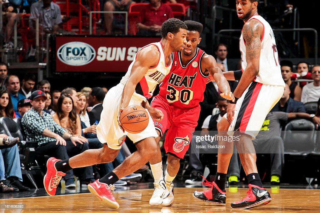 Ronnie Price #24 of the Portland Trail Blazers drives against Norris Cole #30 of the Miami Heat on February 12, 2013 at American Airlines Arena in Miami, Florida.