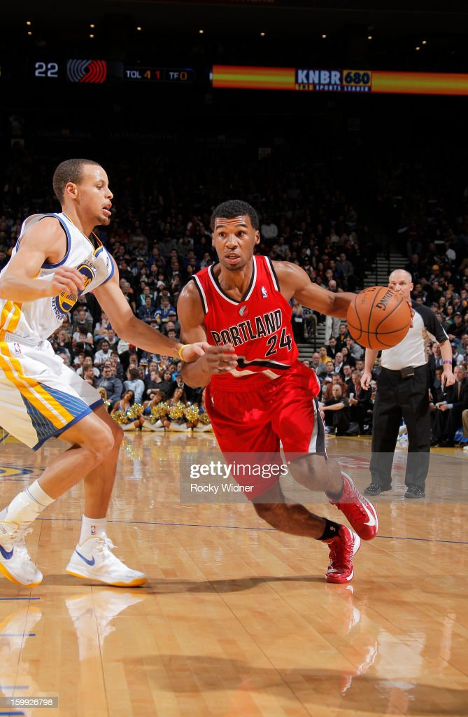 Ronnie Price #24 of the Portland Trail Blazers drives against Stephen Curry #30 of the Golden State Warriors on January 11, 2013 at Oracle Arena in Oakland, California.
