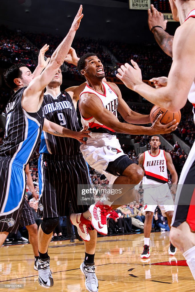 Ronnie Price #24 of the Portland Trail Blazers drives to the basket against J.J. Redick #7 of the Orlando Magic on January 7, 2013 at the Rose Garden Arena in Portland, Oregon.