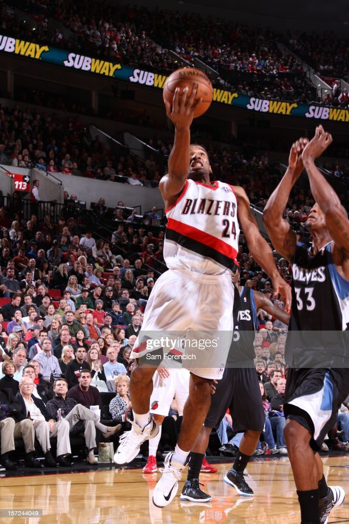 <a gi-track='captionPersonalityLinkClicked' href=/galleries/search?phrase=Ronnie+Price&family=editorial&specificpeople=654750 ng-click='$event.stopPropagation()'>Ronnie Price</a> #24 of the Portland Trail Blazers drives to the basket against <a gi-track='captionPersonalityLinkClicked' href=/galleries/search?phrase=Dante+Cunningham&family=editorial&specificpeople=683729 ng-click='$event.stopPropagation()'>Dante Cunningham</a> #33 of the Minnesota Timberwolves on November 23, 2012 at the Rose Garden Arena in Portland, Oregon.