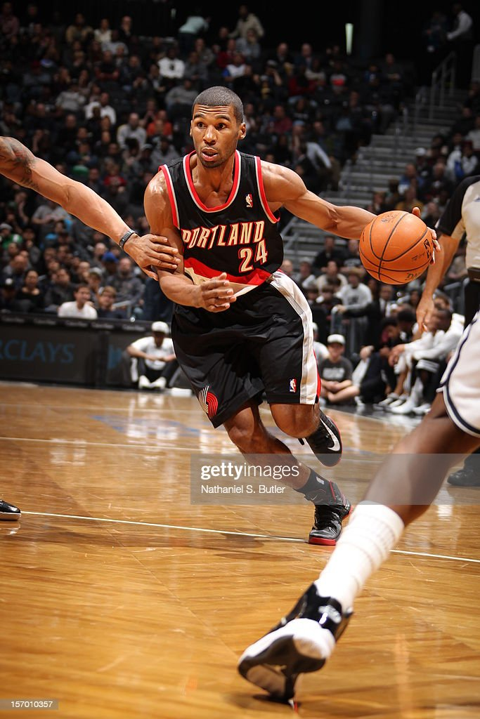 Ronnie Price #24 of the Portland Trail Blazers drives to the basket against the Brooklyn Nets on November 25, 2012 at the Barclays Center in the Brooklyn Borough of New York City.