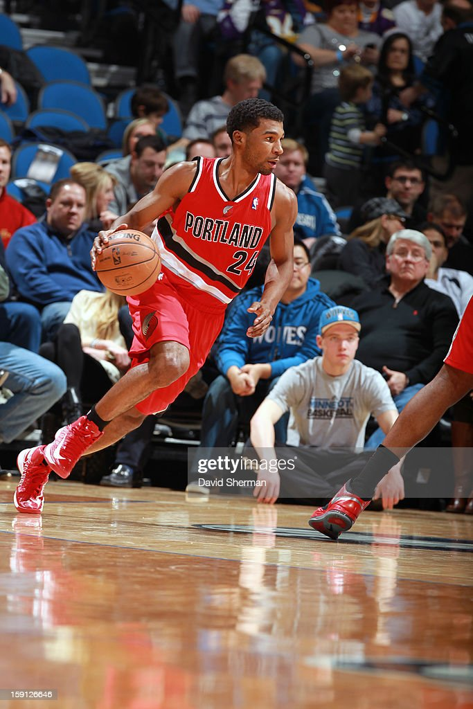 <a gi-track='captionPersonalityLinkClicked' href=/galleries/search?phrase=Ronnie+Price&family=editorial&specificpeople=654750 ng-click='$event.stopPropagation()'>Ronnie Price</a> #24 of the Portland Trail Blazers drives to the basket against the Minnesota Timberwolves on January 5, 2013 at Target Center in Minneapolis, Minnesota.