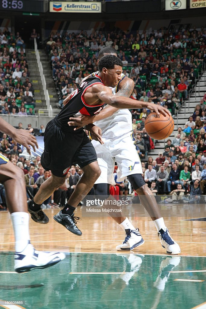 <a gi-track='captionPersonalityLinkClicked' href=/galleries/search?phrase=Ronnie+Price&family=editorial&specificpeople=654750 ng-click='$event.stopPropagation()'>Ronnie Price</a> #24 of the Portland Trail Blazers is fouled by <a gi-track='captionPersonalityLinkClicked' href=/galleries/search?phrase=Derrick+Favors&family=editorial&specificpeople=5792014 ng-click='$event.stopPropagation()'>Derrick Favors</a> #15 of the Utah Jazz at Energy Solutions Arena on February 01, 2013 in Salt Lake City, Utah.