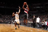 Ronnie Price of the Portland Trail Blazers shoots against MarShon Brooks of the Brooklyn Nets on November 25 2012 at the Barclays Center in the...