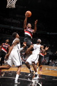 Ronnie Price of the Portland Trail Blazers shoots against Reggie Evans of the Brooklyn Nets on November 25 2012 at the Barclays Center in the...