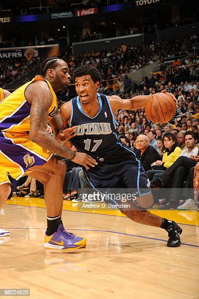 Ronnie Price of the Utah Jazz drives past Josh Powell of the Los Angeles Lakers at Staples Center on April 2 2010 in Los Angeles California NOTE TO...
