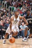 Ronnie Price of the Utah Jazz drives the ball around Jonny Flynn of the Minnesota Timberwolves at EnergySolutions Arena on January 28 2011 in Salt...