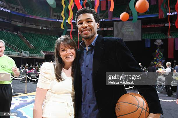 Ronnie Price of the Utah Jazz poses for a photo with a fan during the Leapin' Leaners and Low Tops charity event at EnergySolutions Arena on March 30...