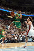 Ronnie Price of the Utah Jazz rebounds against Anderson Varejao of the Cleveland Cavaliers during the game at the EnergySolutions Arena on January 14...